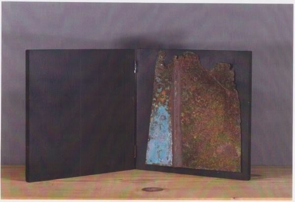 Libro d'artista, 2003, ferro corroso su tavola, 20x20