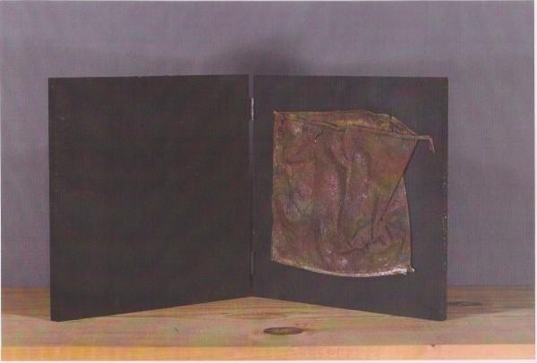 Libro d'artista, 2004, ferro corroso su tavola, 20x20
