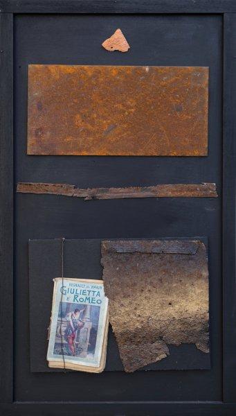 Il passato ritorna, 95x52, ferro, libro su tavola, 2019